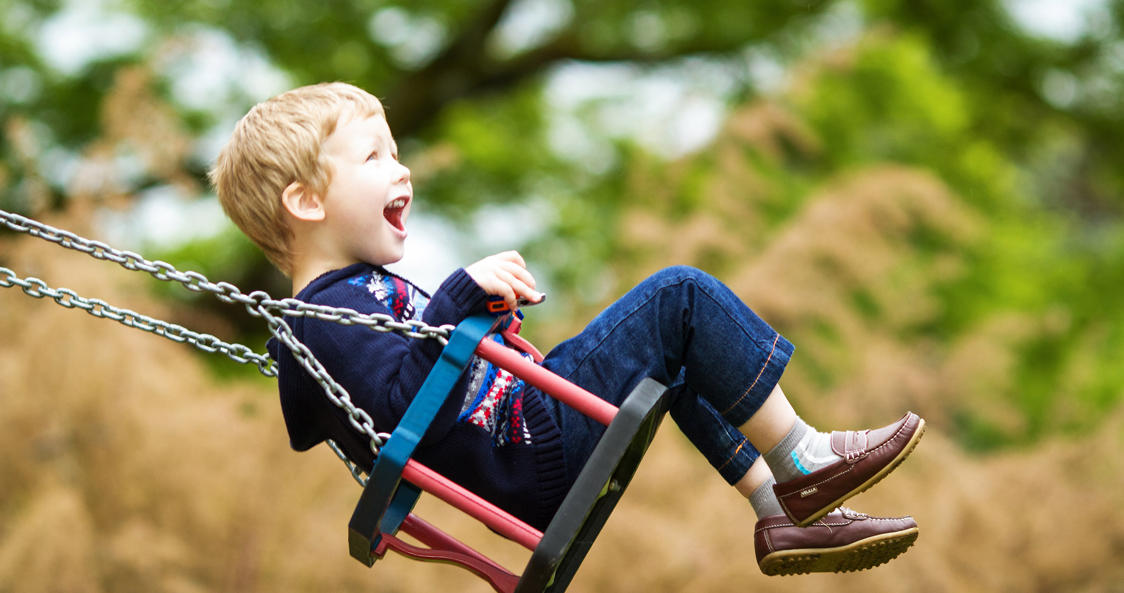 Young boy on swing